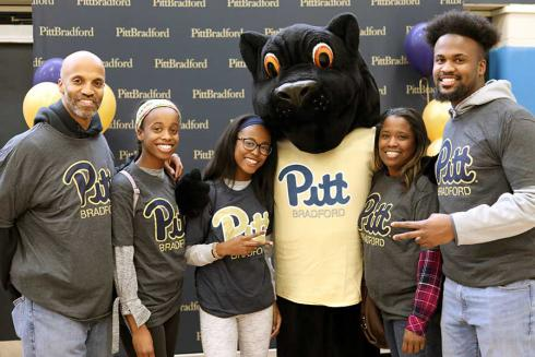 Family and student with panther